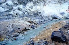 river flowing from a volcano (_cherylh) Tags: travel blue sea nature water rock japan closeup river landscape volcano sand nikon rocks stream hokkaido outdoor stones formation mountainside noboribetsu nikond5100