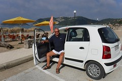 Parking our hired Atos (pj's memories) Tags: stgeorgesbaynorth corfu shorts mensshorts beach umbrella commando