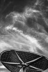 boronia-2208-ps-w (pw-pix) Tags: sky clouds flowers punched pressed textured motif shade structure ribs radials perimeter steel curved angles commercial retail shops evening ir infrared bw blackandwhite irmodifiednikon1v1 720nmir boroniamallshoppingcentre boronia easternsuburbs outereast melbourne victoria australia