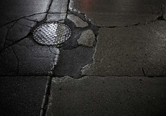 fault lines-230250 (blairware) Tags: guelph ontario canada manhole cracks pavement
