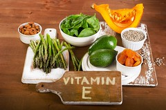 Foods containing vitamin E on a wooden board. (Kuwait Living) Tags: e vitamin food vegetable healthy health organic ingredient fruit seeds sunflower green natural fresh diet pumpkin group source orange metabolism wood collection product different asparagus spinach apricot almond avocado board text latvia