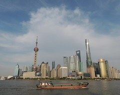 Shanghai skyline crossed by a ship (Germn Vogel) Tags: asia eastasia china travel traveldestinations traveltourism tourism touristattractions shanghai harbor ship cargo transportation huangpo river riverside water waterfront skyscraper skyline clearsky cloud orientalpearltower tower landmark pudong financialdistrict famous