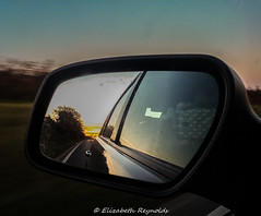 Day 338, 2016, a photo a day. (lizzieisdizzy) Tags: howiemarsh outdoors outside car motor mirror left side reflection sunset sundown colour colourfull backwar scene reverseimage