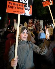 Rabaa al-Adawiya salute during an anti-Sisi demo in London. (alisdare1) Tags: uk london demo freedom justice fuji salute protest egypt hijab demonstration cameron humanrights whitehall protesters sisi tyrant  repression davidcameron muslimbrotherhood  vsit    elsisi  rabaa 16mmf14 egyptsolidarity egyptianpresident rabaaaladawiya generalsisi abdelfattahelsisi fujixt1 adawiya presidentsisi