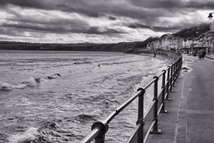 High Tide, Seafront, Filey (robin denton) Tags: sea blackandwhite bw seascape fence coast town blackwhite seaside yorkshire shoreline monotone coastline seafront railings hdr ville northyorkshire eastcoast filey yorkshirecoast