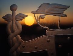 Mercury Chases the Sun (Explored October 23, 2016) (Anne Worner) Tags: anneworner macromondays mercury olympus romangod backlight backlit closeup crystal engraving god godoftrade goldenhour macro sun sunset em5 warm glowing engraved glass texture shallowdof selectivefocus