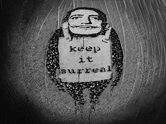 Keep it Surreal (Steve Taylor (Photography)) Tags: art digital graffiti stencil streetart monochrome blackandwhite monotone man newzealand nz southisland canterbury christchurch distorted lines texture vignette keepitsurreal grain salvadordali