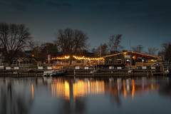 Resturant Lights on the Root River (mraarondouglas) Tags: night nighttime root river water lake michigan lights street stars sunset sun sunsetting clouds cloudy colors colorful color long exposure racine wi wisconsin chicago milwaukee photography photo photograph image canon canon1585 rebel t5 1200d brige drawbridge road main lighthouse rocks harbor marina
