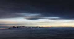 Peaks between the clouds (marko.erman) Tags: flying clouds layers alps peaks mountains snow sunset sony panorama horizon aerial mood moody beautiful sky