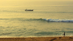 Coalesce (Dream.wide.open) Tags: india vizag scenic beauty nature boat men waves sea serenity flickr sand beach wow