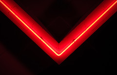 V (xcheneba) Tags: neon dark light color red bright saturated patterns lines designs symmetry pattern abstract lights flikr canon sl1 night