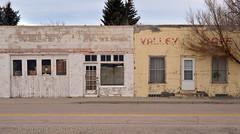 Main Street is not thriving (Patinagal) Tags: relic decay facade commercial mainstreet windows doors patina garage