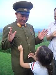 DPRK Tourist child grabs insect (KoryoTours) Tags: people korea northkorea dprk koryo culturalexchange northkorean koryotours