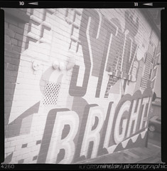 Stay Bright! (Mindori Photographic) Tags: blackandwhite streetart 6x6 film wall analog mediumformat graffiti mural sheffield ilfordhp5 hp5 365 analogue ilford sporti project365 ilfordsporti filmisnotdead 365days rockinghamstreet staybright