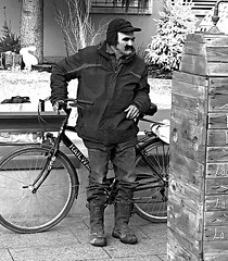 Man with mustache (Eric_G73) Tags: christmas street people blackandwhite bw man france bike bicycle person noiretblanc market candid streetphotography streetlife nb marchédenoël candidphotography annemasse
