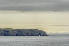 Boran, Faroe Islands (Esbern Christiansen) Tags: ocean travel sea sky lighthouse nature water rock landscape islands coast rocks outdoor mountainside faroeislands faroe bordan nolsoy nlsoy boran borholi bordholid