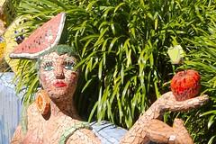 Hungry?  Want a Bite of My Apple? (Piedmont Fossil) Tags: newzealand sculpture house art apple fruit garden mosaic giants watermellon akaroa