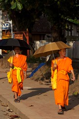 SONY2_ 037283 (andi islinger) Tags: people umbrella luangprabang streetscenes select buddhistmonk asia2012 2all2010 wmbpicall laosall laos3oct2012 sony2037283jpg