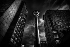 Calgary Tower B&W (qualistat) Tags: city buildings bw dark calgary tower moody