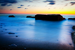 Coastal Landscape after Sunset (k_maxim) Tags: tranquilscene sea water stone rock landscape horizon pebble beach moss sky nature scenics night watersedge morning outdoors cloud moodysky seascape coastline dusk idyllic travellocations landscapes bodiesofwater horizonoverwater wildernessarea rockycoastline twilight loneliness boulder solitude vacations beaches