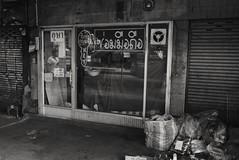KEY Position - Sukhumvit Rd, Bangkok (jcbkk1956) Tags: bangkok thailand street shop shutters mono blackwhite sukhumvitroad thonglo nikon d3300 nikkor 18140mmdxf3556 key reflection worldtrekker