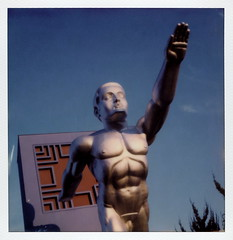 The Tenor (tobysx70) Tags: the impossible project tip polaroid slr680 frankenroid sx70 door rollers color film for 600 type cameras impossaroid tenor state fair of texas park dallas tx esplanade fountian bronze aluminum aluminium sculpture statue david newton recreation lawrence tenney stevens 1936 dick cock penis breasts nipples 6pack sixpack polacon2016 polaconone 093016 toby hancock photography