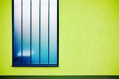 Blue window (Kunfy Nomyek) Tags: blue 85mm nikkor nikon street bars pattern window fx urban streetscene enlight d610