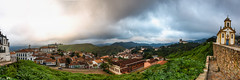Ouro Preto Pan 1 (D Song) Tags: old city travel blue sunset brazil sky panorama playing mountains streets green heritage church architecture kids buildings children churches panoramic historic unesco cobblestone vista belohorizonte hilly favela ouropreto slums
