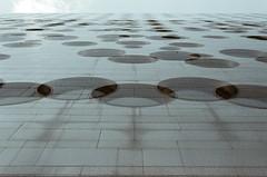 (Pheral Lamb) Tags: city nyc windows newyork building film wall chelsea fuji doubleexposure manhattan circles multipleexposure portholes maritimehotel 28105 nikonf4 press800 maritimeunionbuilding