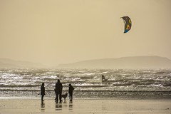 Walkers and Surfers (Nikki & Tom) Tags: uk light sea dogs wales surf walkers windsurfers pembreybeach