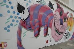 Grinning (Meegz-Kathleen) Tags: street pink art smiling cat wonder cards paint alice markets australia cheeky spray western land grin grinning meow smirk freo spades pruple grinner smilke