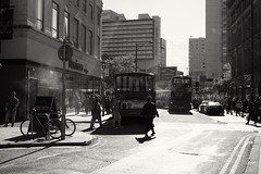 Saturday afternoons (The Green Hornet ( Manchester)) Tags: manchester monochrome fujix100t atmosphere streets documentary street photograpy bus stagecoach oldhamstreet northernquarter saturday afternoon light shadow people city urban life standing smoke haze