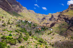 Masca (rawyvandenbeucken) Tags: 2013 masca tenerife costaadeje october canaryislands spain blue brown green orange white mountain rock sky clouds road house pirate