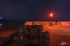 At Last Light (Tim van Zundert) Tags: tenby harbour dinbychypysgod west wales carmarthen street scene photography night evening long exposure light lamp sky dark red orange crates fishing cages sony a7r voigtlander 21mm ultron