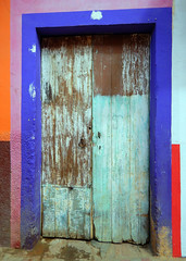 Bright wall with a blue door in Talpa, one of Mexico's Pueblos Magicos in the Pacific high sierras (albatz) Tags: sierramadre westcoast buildings talpa mexico pueblosmagicos pacific high sierra wall bright door jalisco town
