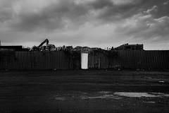 un.spoken (jonathancastellino) Tags: hamilton achitecture wrecker door landscape ruin ruins sky cloud clouds leica q arm wreckingyard industrial unspoken facade cover