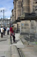 The queue starts here (David_Leicafan) Tags: hat bag waiting edinburgh candid railing leaning redhotchillipeppers 50mmsummicronv5