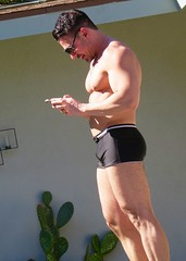 IMG_0300 (danimaniacs) Tags: shirtless hot guy man hunk stud mansolo muscle muscular swimsuit trunks bulge cellphone