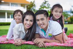 Beautiful family portrait smiling outside their new house (anekphoto) Tags: new family sunset portrait people woman house man cute home beautiful smile loving kids female sunrise daddy mom relax asian fun thailand outside happy person parents togetherness team asia picnic dad village child play sweet brothers outdoor sleep father mother adorable lifestyle mum together thai latin males lovely cheerful bonding