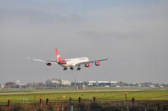 'VS8E' (VS0008) LAX-LHR (A380spotter) Tags: london heathrow landing finals 600 airbus vs arrival approach lhr a340 vir soulsister egll laxlhr virginatlanticairways gvblu 09l shortfinals britainsflagcarrier vs0008 airbornjanuary2006 runway09l vs8e