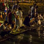Thai people setting their candle-lit krathongs in the Ping river at night during Loy Krathong 2015-182 thumbnail