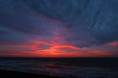 amroth sunrise (echail) Tags: winter red sea sky orange beach wales sunrise coast waves spray pembrokeshire atmospheric amroth fireinthesky roughseas