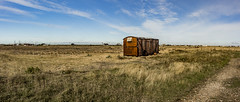Deserted Wasteland (Dangle Photography) Tags: landscape panoramic panorama abanodne grass arictecture wasteland dungeness art photography photographer 17 years old bracketing travel uk canon space autumn sky