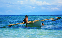 Fishing (free3yourmind) Tags: fishing children boys sea boat local traditional clouds cloudy bohol philippines blue green water