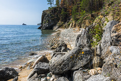 The lake shore is covered with stones (Ivanov Andrey) Tags: lake water rock cliff slope shore stone moss pine pinewood wood sand bay surf wave sky cloud horizon sun sunset evening blue skyblue green black trunk branch crown leaf bark rootwood wind coast coastline landscape shade wildlife travel tourism summer north lakebaikal russia