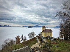 Yellow House on top of a mountain in the clouds near Lugano, (onnobos) Tags: orange new trees light art blue green tree red sky storm landschaft hill mono white low autumn brown lugano blanket top mountain topoftheworld clouds house old yellow beautiful switzerland