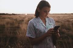 stay in touch... (Novel Photographie) Tags: eveninglight evening socialmedia phone field vintagedress teenportraits teens girl teengirl
