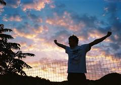 Mr. Sunset at sunset (Arianna Rubini) Tags: sunset clouds sky simple beauty boy summer holiday sardegna sardinia kodak 400 ultramax olympusmjuii olympus mjuii mju ii italy pink nature wild wanderlust film 35mm analog analogue ariannarubini youth young