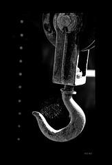 off the hook... (Stu Bo) Tags: beautiful blackandwhite bw hook machine light shadows smooth sbimageworks metal work monotone outdoor junkyard