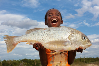 Madagascar, happy girl with fish